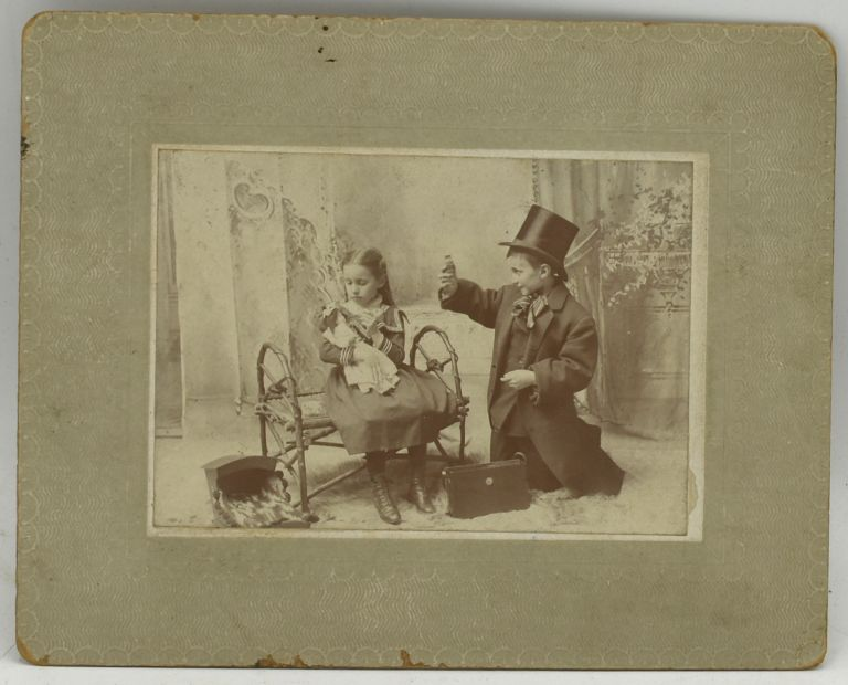 [MOUNTED PHOTOGRAPH] TWO CHILDREN PLAYING DOCTOR.