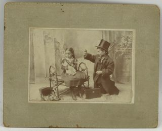 MOUNTED PHOTOGRAPH] TWO CHILDREN PLAYING DOCTOR